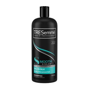 A 900ml bottle of TRESemmé Salon Silk Shampoo front of pack image