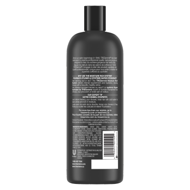 A 828 ml bottle of Moisture Rich Shampoo back of pack image