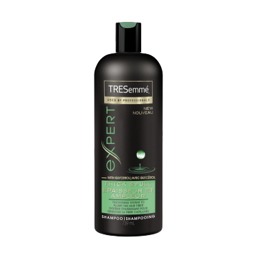 A 739 ml bottle of Thick & Full Shampoo front of pack image
