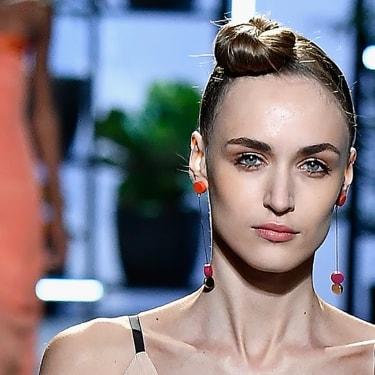 Model with elegant chignon front bun