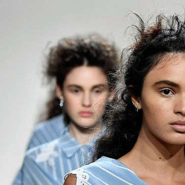 Model with windswept twisted half crown hair