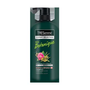 A 580ml bottle of Tresemme Botanique Replenish  Shampoo front of pack image