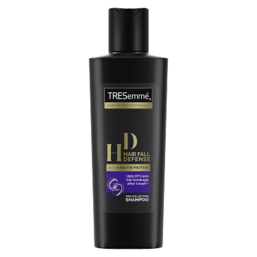 A 80ml bottle of TRESemmé Hair Fall Defense Shampoo front of pack image