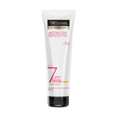 A 250ml bottle of TRESemmé 7 Day Smooth Conditioner front of pack image