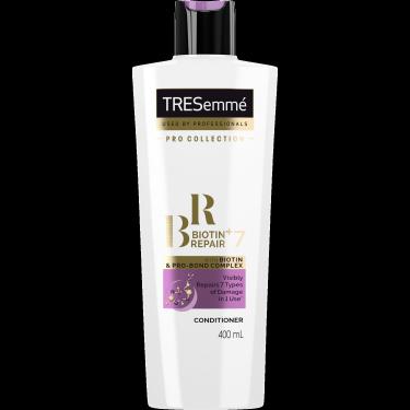 A 400ml bottle of TRESemmé Biotin + Repair 7 front of pack