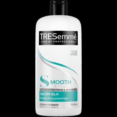 A 900ml bottle of TRESemmé Salon Silk Shampoo front of pack image