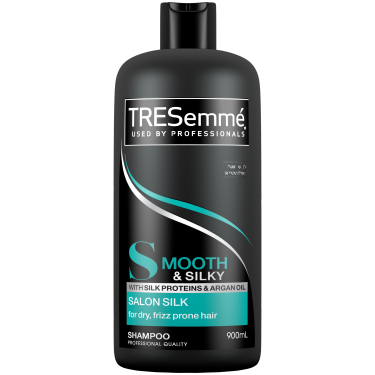 A 900ml bottle of TRESemmé Salon Silk Conditioner front of pack image