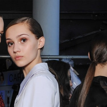 A young woman profile with nice and sleek low ponytail