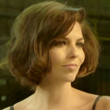 Woman with dark brown hair in a faux bob hairstyle