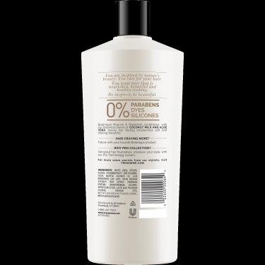 A 22oz bottle of TRESemmé Botanique Nourish and Replenish Conditioner back of pack image