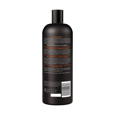 A 25oz bottle of TRESemmé Perfectly (un)Done Shampoo back of pack image