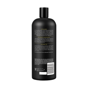 A 28oz bottle of TRESemmé Purify and Replenish Deep Cleansing Shampoo back of pack image