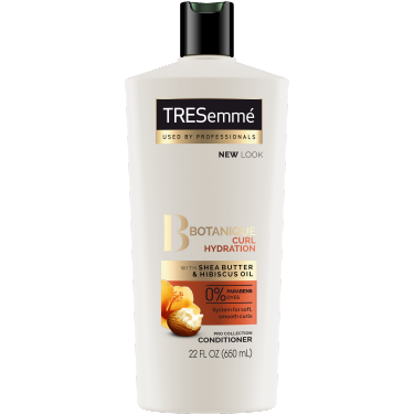 A 22oz bottle of TRESemmé Botanique Curl Hydration Conditioner front of pack image