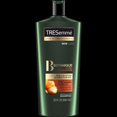 A 22oz bottle of TRESemmé Botanique Curl Hydration Shampoo front of pack image