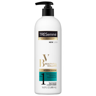 A 16.5oz bottle of TRESemmé Beauty-Full Volume Pre-Wash Conditioner front of pack image