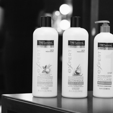 Three bottles of TRESemmé Conditioner