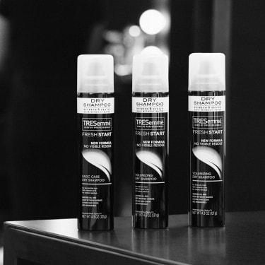 Three cans of TRESemmé Fresh Start Dry Shampoo