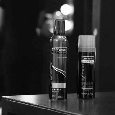 Two cans of TRESemmé hair mousse