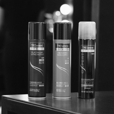 Three cans of TRESemmé hair spray